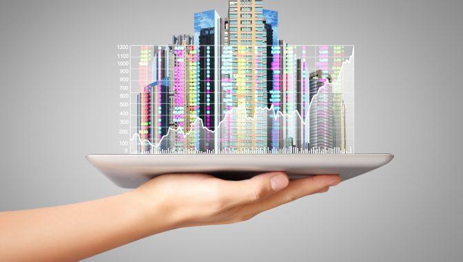 Eine Hand die das Gesamtpaket für Immobilienmanagement in einer Hand hält